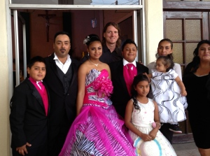 Wayne with Carlos' family last year at his daughter's quinceañera.